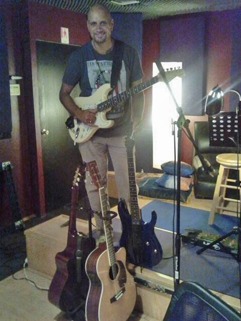 Fabian Fernandez in studio with guitars